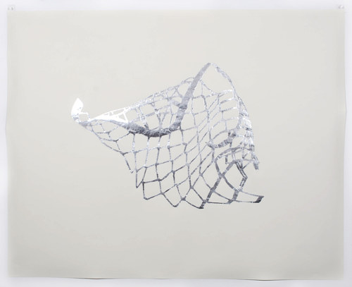 "A ""drawing"" made from hand cut foil on paper"
