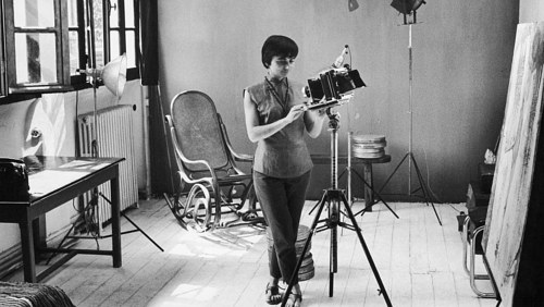 A photograph of Agnes Varda in her studio