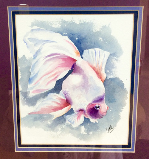 A watercolor painting of a fancy goldfish
