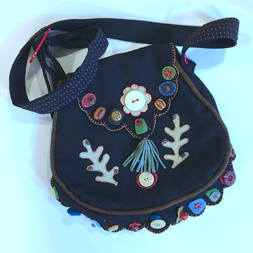 A purse made with wool applique