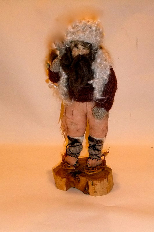 A handmade fiber doll of a mountain man