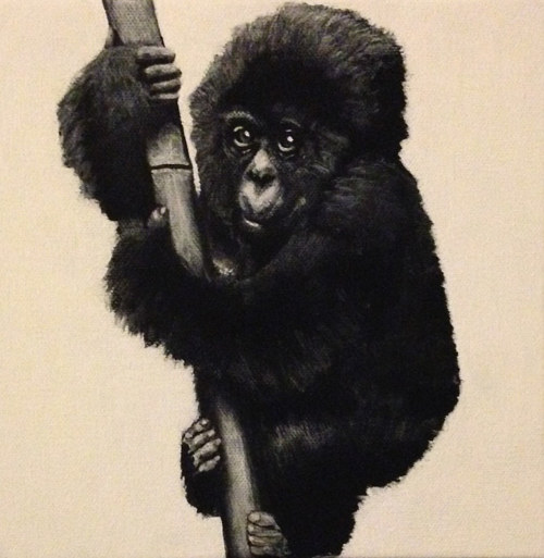 A small painting of a baby gorilla on a bamboo pole