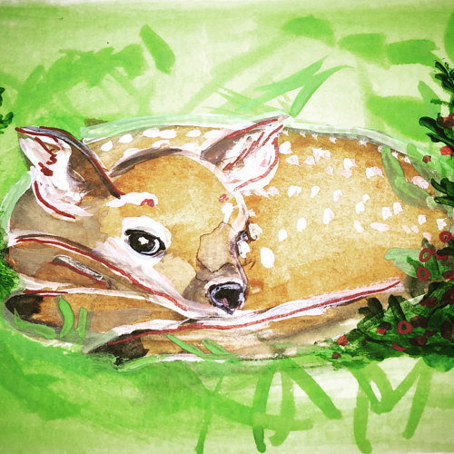 A watercolor painting of a deer on paper