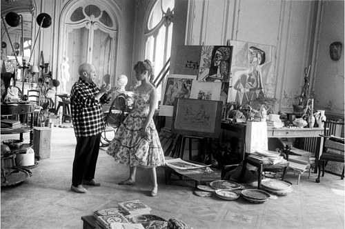 A photo of Pablo Picasso in his studio with Brigitte Bardot