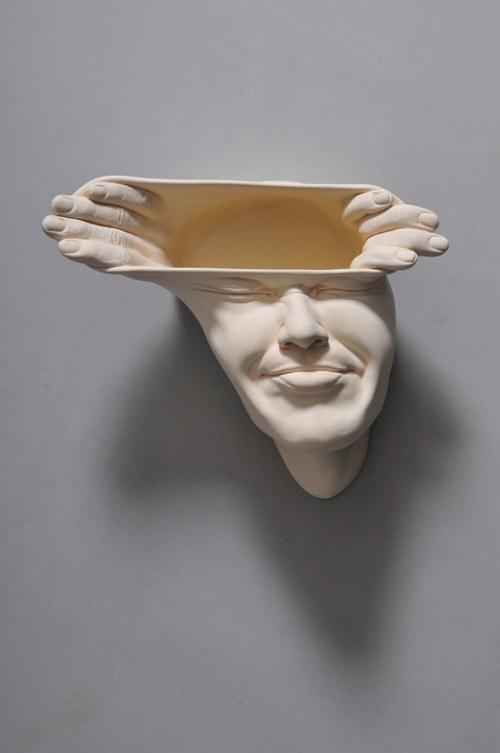 A distorted face ceramic sculpture