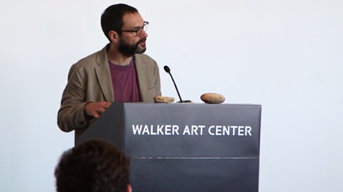A photo of Sam Durant speaking at the Walker Art Center