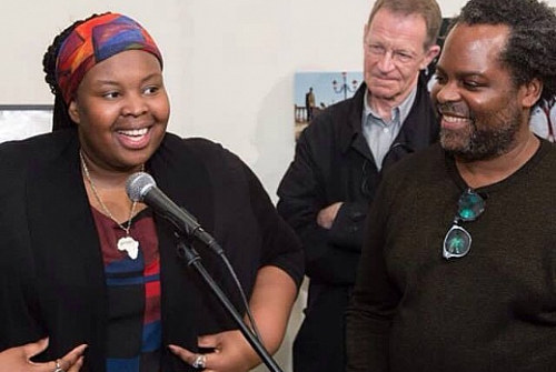 A photo of artist Khadija Saye speaking at the Venice Biennale
