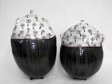 A pair of ceramic jars by Pauline Doyle