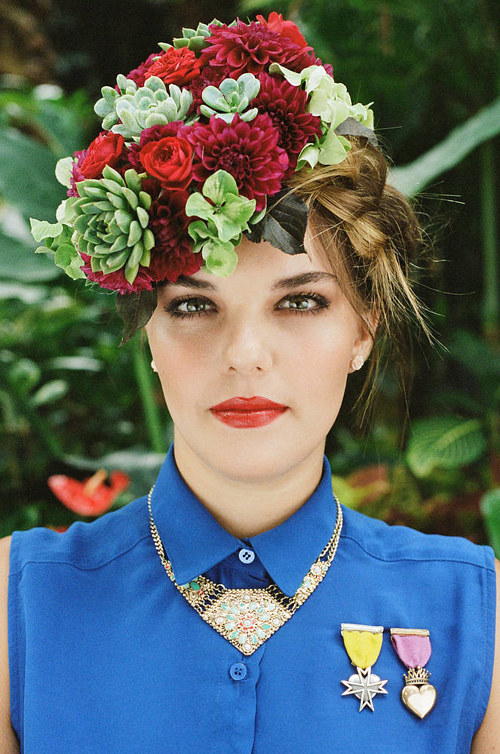 A photo of a woman with a crown of flowers
