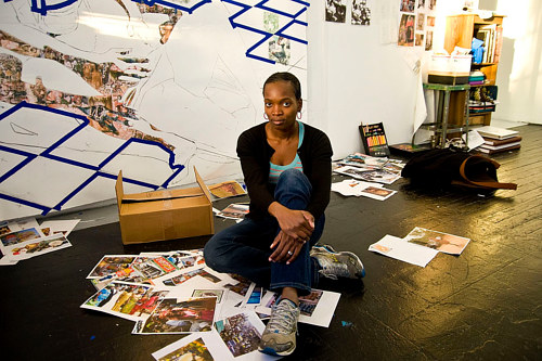 A photo of Njideka Akunyili Crosby in her studio