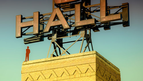 A photo of a vintage rooftop building sign