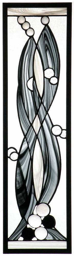 stained glass artwork with swirling lines