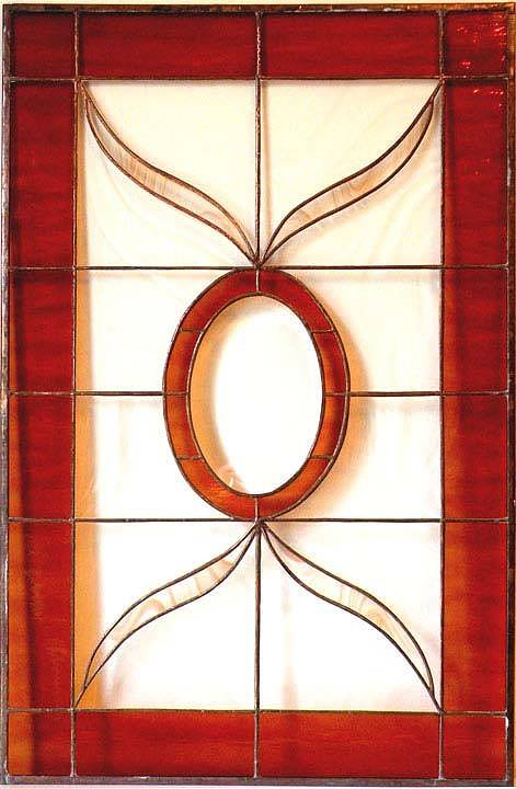 Red stained glass artwork with a hole in the centre