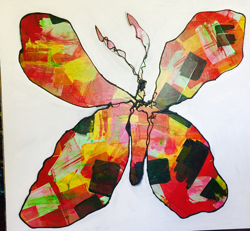A mixed media artwork of a colorful butterfly