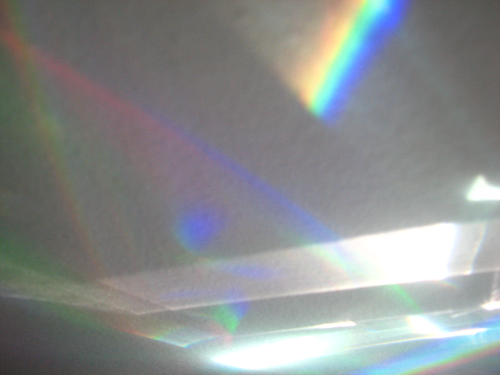 An abstract photograph of light refracting into a rainbow