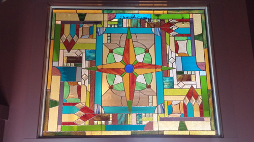 A custom stained glass panel with a geometric pattern