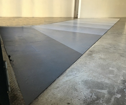 An installation view of a gradient panel in a gallery floor