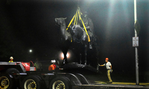 Workers remove a confederate monument in Baltimore