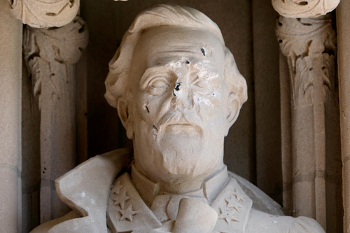 A photo of a damaged statue of Robert E. Lee