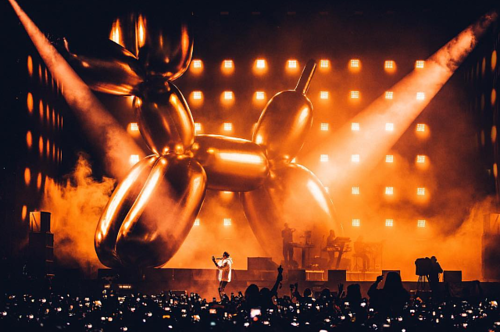 A photo of Jay-Z performing with a Jeff Koons Balloon Dog