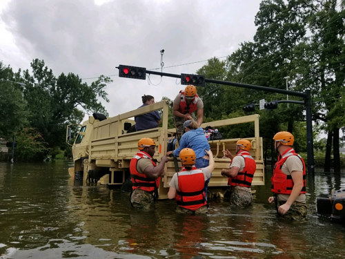 Emergency responders aid residents affected by flooding in Texas