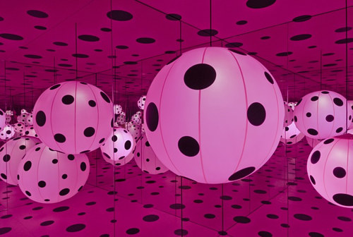 A photo of the interior of one of Yayoi Kusama's Infinity Rooms