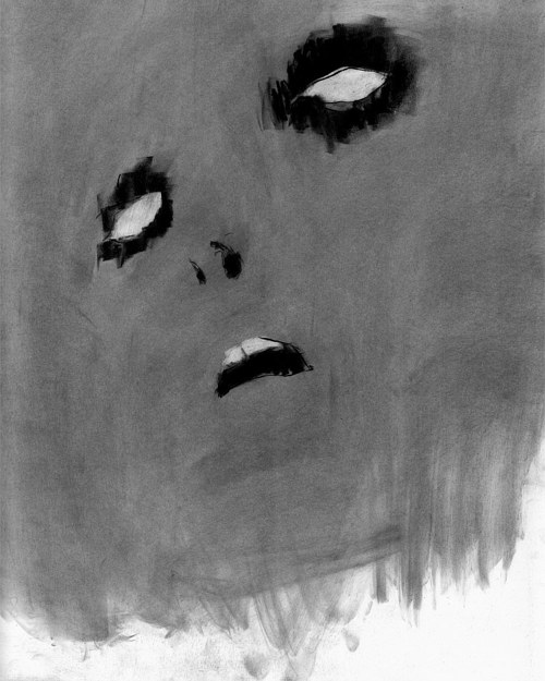 A black and white drawing of a simple face