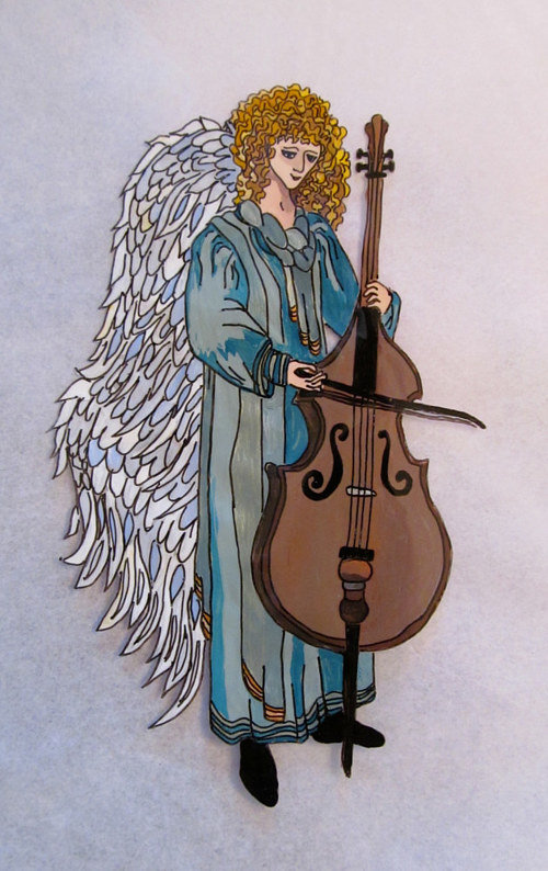 An acetate image of an angel playing a cello