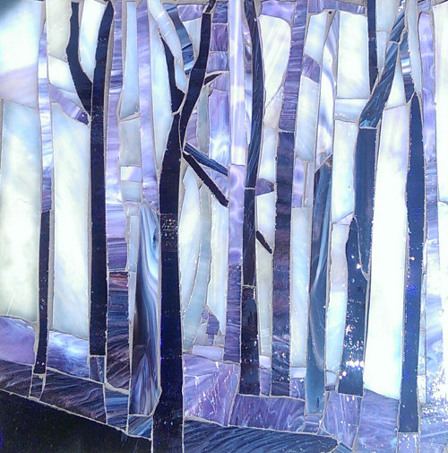 A mosaic glass work with tall trees and blue colors