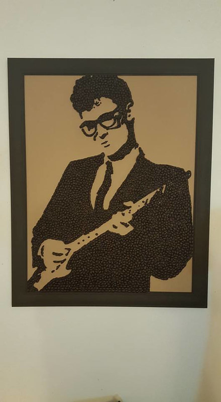 A portrait of Buddy Holly made with coffee beans