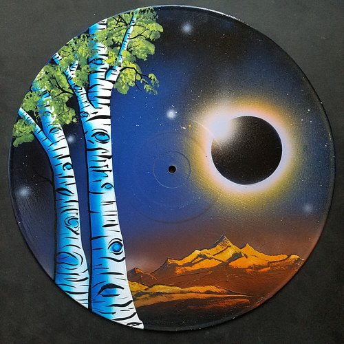A painting of pale tress on a vinyl record