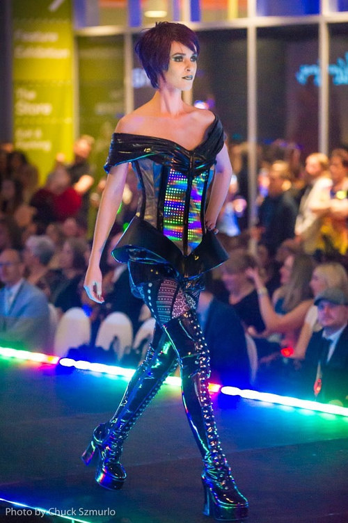 A photo of a woman modelling a futuristic fashion design