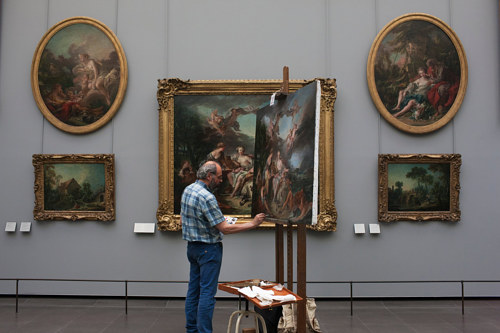 A photo of an artist copying a masterpiece in a museum