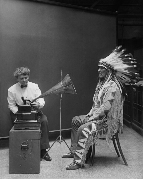 A Smithsonian ethnographer recording speech from a Blackfoot chief in 1916