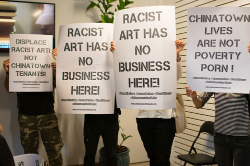 A photo of protesters inside Omer Fast's installtion at the James Cohen gallery in Manhattan's Chinatown