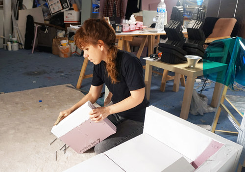 A photo of Samara Golden working in her studio