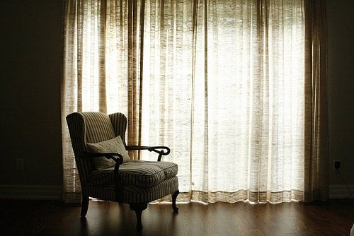 Chair with curtains and window