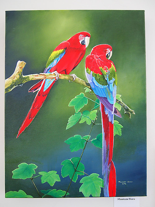 A painting of two parrots on a branch