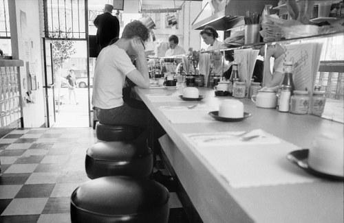 A photograph of a San Francisco diner in the 1980's