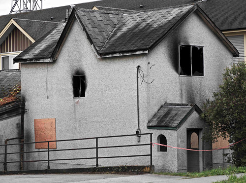 A photo of a burned out house in Nanaimo