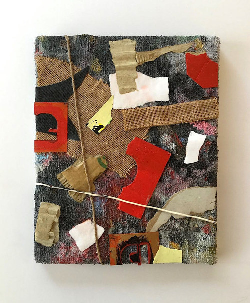 A canvas covered in burlap and various found items