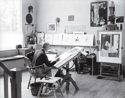 A photo of Norman Rockwell at work in his studio