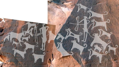 A photo of some ancient cave paintings potentially depicting leashed dogs