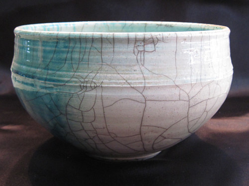 A ceramic bowl with small cracks running through the glaze