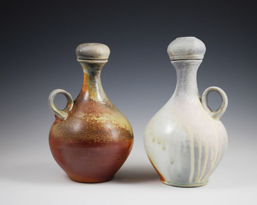 A photo of two wood-fired clay vessels