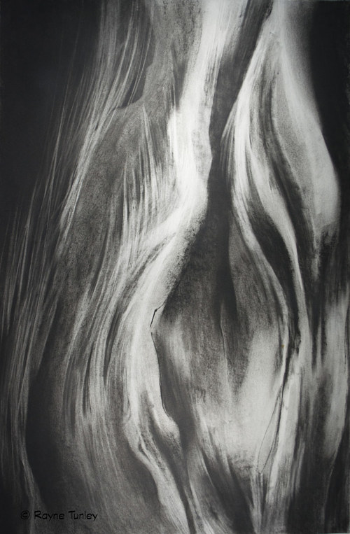 A charcoal drawing of flowing abstract lines