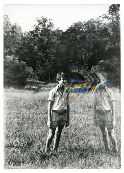Black and White Photo man on grass with color waves
