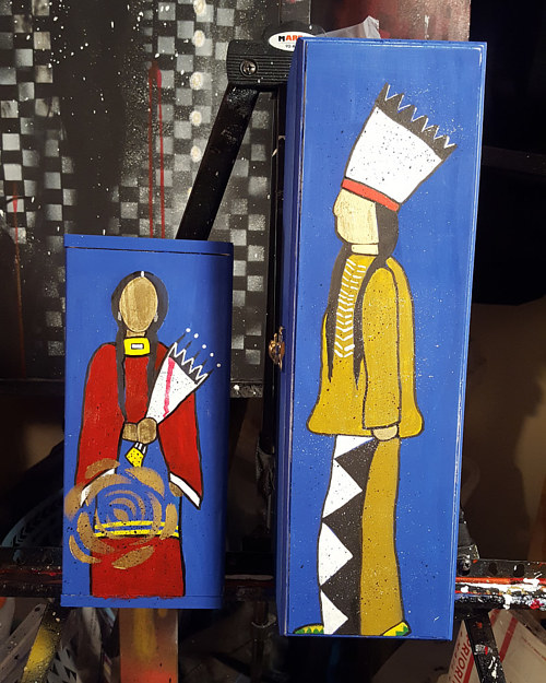 A photo of a pair of hand-painted wooden boxes