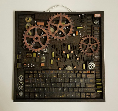 An art piece made with discarded computer parts and wooden gears