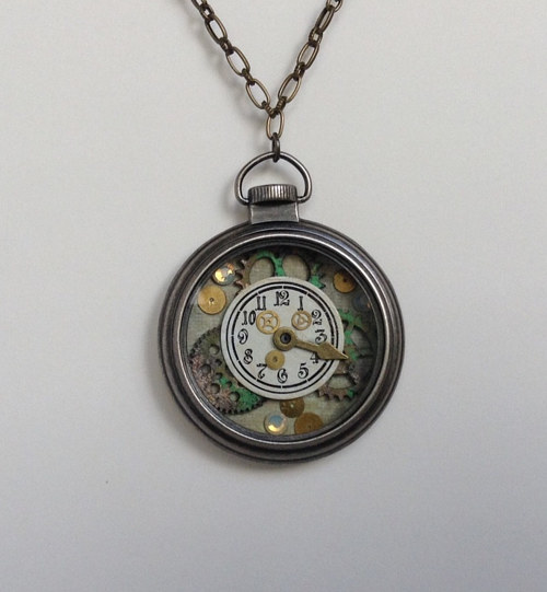 A piece of jewelry made from a pocket watch casing